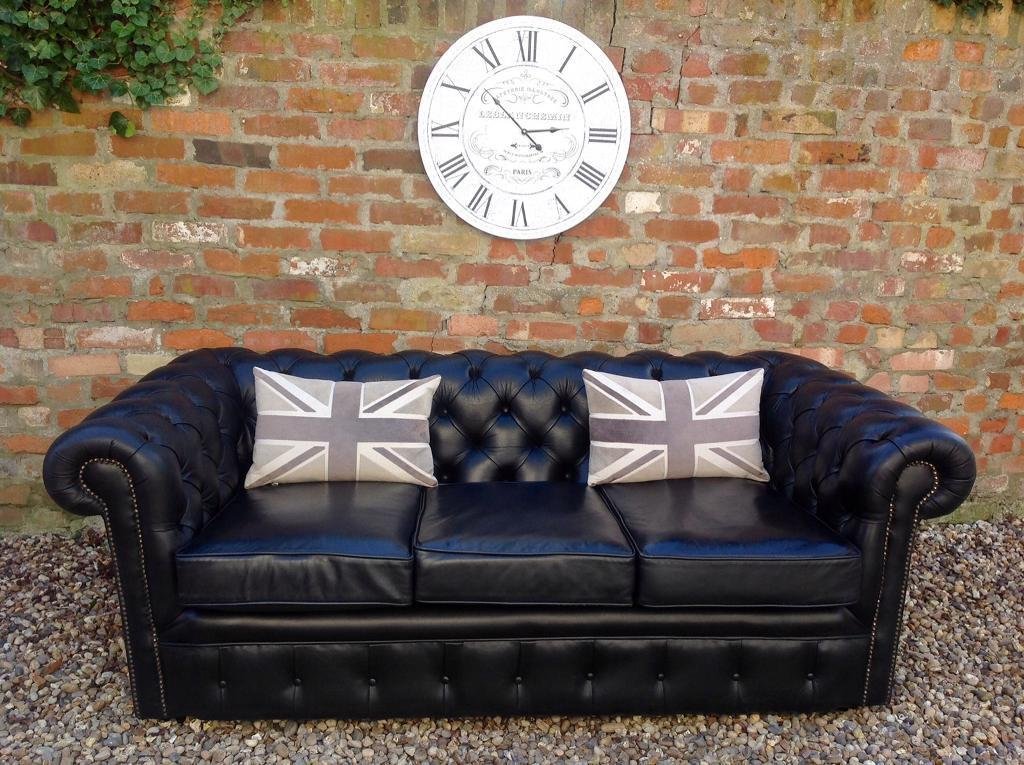 Black leather chesterfield sofa. Can deliver