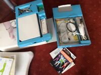 Wii console, balance board, controls, instructions, 11 DVD's incl dance, sport, skying, games