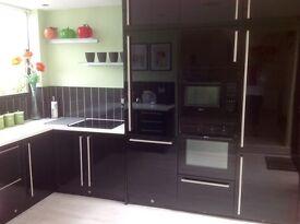 Integrated black gloss oven - combi/microwave - fridge freezer.