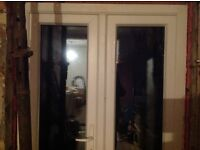 White UPVC double glazed patio doors in good condition.
