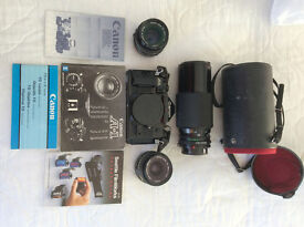 Camera A-1 in MINT condition, Telephoto lense, Sunpak Flash, Wide Angle Lense, Western Strap, Bag