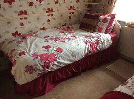 Two single divan beds with headboards .will sell either together or individually.