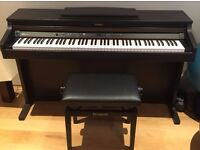 Roland Digital Piano HP102e for sale. Hardly used
