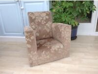 Child's armchair. Neutral colours.