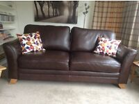 Chocolate brown leather 3 seater sofa.