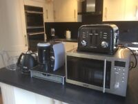 Electric kettle toaster microwave and coffee machine.