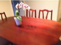 Oval dark wood dining table with matching six chairs -excellent condition