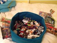 Massive box of Lego with manuals