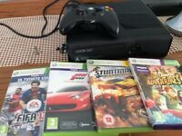 X-Box 360. Boxed, 4 controllers & 4 games. Good used condition.