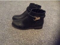 A brand new pair of black boots from F&F in a size 6.