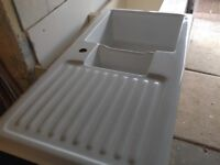 White porcelain one and a half bowl sink