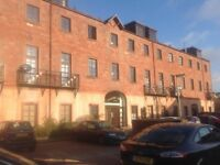 Attractive 1 bed flat in modern block with private parking