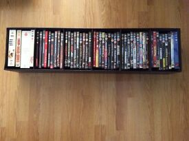 Selection of dvds (see photos) plus faux leather DVD storage