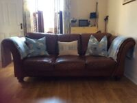 1 Brown leather 3 seater sofa, selling for £225