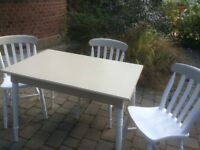 Painted pine table and four chairs
