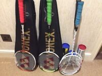 2 Yonex Voltric 5 badminton rackets + 2 Carlton rackets for sale.