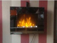 Mirrored wall mounted remote control dimmer electric fire