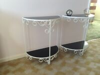 Matching pair of while decorative framed tables each with 2 black glass shelves