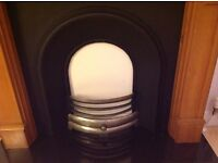 Fireplace with pine surround and cast insert and granite hearth £250
