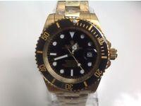 Rolex – submariner – all gold – black face