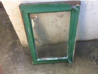 Aluminium Opening window in wooden frame removed from block shed