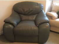 2 green leather armchairs. Have fire safety labels. Excellent condition.