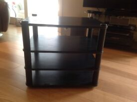 Black stand for hi fi separates or TV. Spiked feet. Good condition.