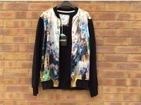 Cuckoo nest design - bomber jacket - never been worn. Size large.