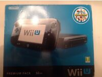 Nintendo Wii U in good condition with 5 games may accept offers