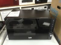 Beko intergrated black microwave. £125 new/graded 12 month Gtee