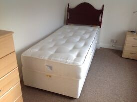Single divan bed base and mattress with headboard
