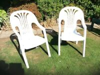 2 of White plastic garden chairs made by Flair