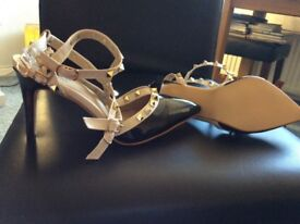 Strapped shoes with studs come in black n nude also nude n black size 5