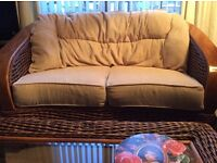 Cane conservatory sofa and coffee table