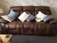 Brown leather reclining 3 seater and 2 seater sofa.