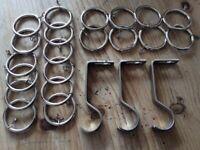 20 Curtain rod/pole rings. Chrome. Also 4 brackets.