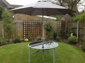 Patio table with glass top and parasol