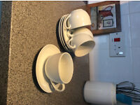 4 white cups and saucers