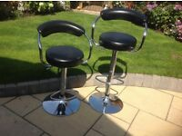 2 Bar Stools in Black Leatherette adjustable height, good condition