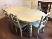 Dining table and 6 chairs for sale.