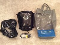 New Buffalo magnetic tank bag never used with rain cover and straps.