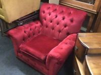 A pair of Chesterfield armchairs
