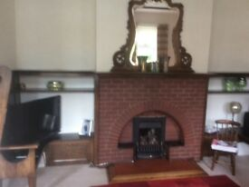Large oak over mantel mirrow