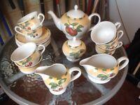 Cups, saucers, tea plates. teapot, 2 milk jugs and sugar bowl.