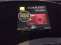 Brand New- Nikon digital camera (red) for only £60. Unwanted Gift.