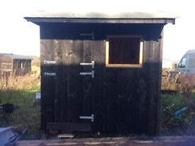 Wooden stable for pony. Hand built on a steel base
