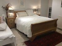 Kingsize solid wood sleigh bed £290 (and free kingsize mattress)