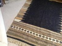 Black, Brown and cream rug