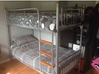 Single metal bunk bed, complete with 1 single mattress, in excellent condition