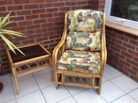 Cane conservatory furniture of table and chairs.